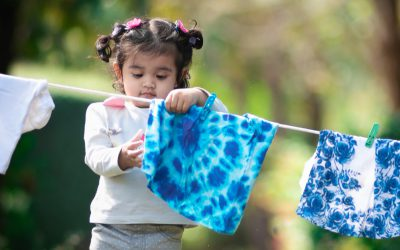 Child hanging clothes on a line